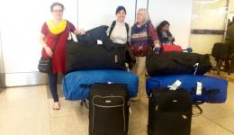 Our team and a lot of bags full of caps at the Delhi airport.