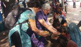Ingrid and Erni distributing the fresh and popular potato pancakes (stuffed parantha).