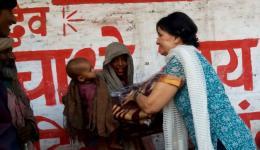 Erni giving away a blanket.