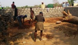 No sooner has the delivery of construction material arrived in the colony, work is started. The residents are enthusiastic about the support and everybody is helping.