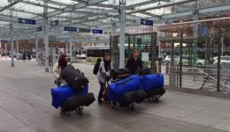 "Jürgen, Petra and Alexandra come ""rolling"" along.  Seven big bags full of caps plus the personal luggage. On their way to the check-in in the  Nuremberg airport."