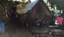 The hut of a widow with four children, who is receiving additional financial help from FriendCircle WorldHelp. Inside all is wet.