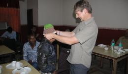 Nils crocheted a cap which Raja receives here. (Raja is a former street child and will now soon return to School again.)