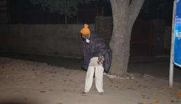 This man was sitting right there crouching, without any blanket, without shoes. Also his cap is from FriendCircle WorldHelp.