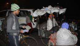 Also handicapped persons are receiving blankets and caps.