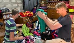 Here, children get clothes.