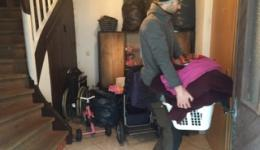 Michael is helping with moving to the first flor. The father of the Family is bound to the wheelchair.