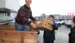 """Wendelin and Lukas are unloading parcels which have been collected by the group from Kirchlauter called """"I have a dream""""."""
