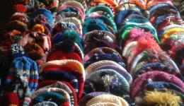 Many caps knitted with love are waiting to be handed over.